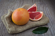 Grapefruit Photo Framed Prints - Pink grapefruit Framed Print by Sabino Parente