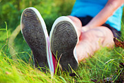 Adolescence Photos - Pink sneakers on girl legs on grass by Michal Bednarek