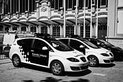 Nord Prints - policia guardia urbana patrol cars outside estacio del nord station Barcelona Catalonia Spain Print by Joe Fox