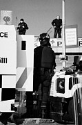 Unrest Photo Framed Prints - PSNI officers in protective riot gear at landrovers and snipers on crumlin road at ardoyne shops bel Framed Print by Joe Fox
