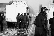 Unrest Framed Prints - PSNI riot officers behind water canon during rioting on crumlin road at ardoyne shops belfast 12th J Framed Print by Joe Fox