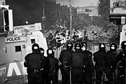 Unrest Framed Prints - PSNI riot officers face rioters mob on crumlin road at ardoyne shops belfast 12th July Framed Print by Joe Fox