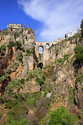 Arched Bridge Photos - Puente Nuevo in Ronda by Artur Bogacki