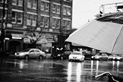 Busy City Photos - rain falling off a umbrella on a wet rainy day in downtown Vancouver BC Canada by Joe Fox