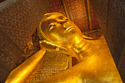 God Art Framed Prints - Reclining Buddha gold statue face Framed Print by Anek Suwannaphoom