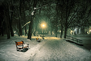 Snowy Night Art - Red bench in the park by Jaroslaw Grudzinski