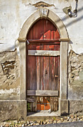 Medieval Entrance Posters - Red Wood Door of the Medieval Village of Pombal Poster by David Letts