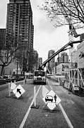 Construction Zone Prints - road closed to traffic to allow large articulated crane operate at building site Vancouver BC Canada Print by Joe Fox