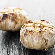 Food And Beverage Photos - Roasted garlic bulbs by Elena Elisseeva