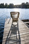 Wicker Chairs Framed Prints - Rocking chair on dock Framed Print by Elena Elisseeva