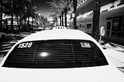 Rooftop Prints - Rooftop Taxi Sign On Cab In Row Of Yellow Cab Taxis In Miami South Beach Florida Usa Print by Joe Fox