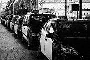 Catalunya Prints - Row Of Black And Yellow Taxi Cabs In Barcelona Port Catalonia Spain Print by Joe Fox