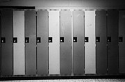 Hallways Prints - row of locked school lockers in empty corridor of High school canada north america Print by Joe Fox