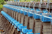 Sluice Prints - Row of Sluice Gates at a Reservoir Print by Yali Shi