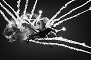 Smoke Trails Posters - Royal Netherlands Air Force Apache AH-64D firing decoy flares RIAT 2005 RAF Fairford  Poster by Joe Fox