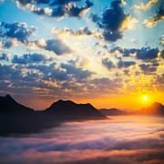 Mountain View Posters - Sea of clouds on sunrise with ray lighting Poster by Setsiri Silapasuwanchai