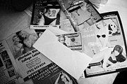 Prostitutes Photo Framed Prints - Selection Of Leaflets Advertising Girls Laid Out On A Hotel Bed With Us Dollars Cash In An Envelope  Framed Print by Joe Fox