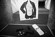 Practise Framed Prints - Smith And Wesson 9mm Handgun With Ammunition At A Gun Range Framed Print by Joe Fox