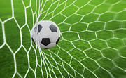 Netting Photos - Soccer Ball In Goal  by Anek Suwannaphoom