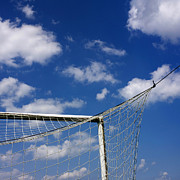 Tied-up Photo Framed Prints - Soccer goal net against cloudy sky Framed Print by Bernard Jaubert