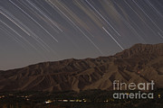 Star Valley Prints - Star Trails Above A Valley Print by Amin Jamshidi