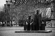 Berlin Germany Framed Prints - statues of marx and engels with deconstruction of the palast der republik in the background Berlin Germany Framed Print by Joe Fox