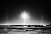 Halo Framed Prints - sun dog parhelion halo due to ice crystals surrounding the sun in Saskatchewan Canada Framed Print by Joe Fox