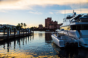 Boats At Dock Prints - Sunset over the water at a tropical marina Print by Michel Sun