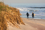 Hamptons Photos - Surfers at Beach Westhampton New York by Bob Savage