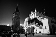 Polish City Framed Prints - The 16th century Cloth Hall Sukiennice building and 13th century  Gothic town hall tower with tourists in rynek glowny town square krakow Framed Print by Joe Fox