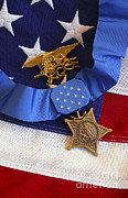 Military Medal Photo Framed Prints - The Medal Of Honor Rests On A Flag Framed Print by Stocktrek Images