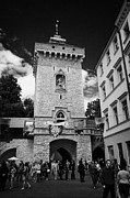 Polish City Prints - tourists and visitors at the Florianska Gate old city entrance to krakow Print by Joe Fox