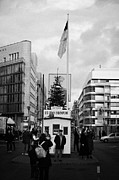 Berlin Germany Framed Prints - tourists at checkpoint charlie ersatz cabin reconstruction in the middle of Friedrichstrasse Berlin Framed Print by Joe Fox
