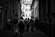 Roman Streets Prints - tourists walk down narrow back streets in the old city Rome Lazio Italy Print by Joe Fox