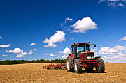 Horizon Metal Prints - Tractor in plowed field Metal Print by Elena Elisseeva