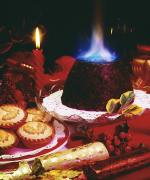 Fire Crackers Prints - Traditional Christmas Dinner In Ireland Print by The Irish Image Collection
