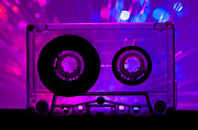 Cassette Tape Posters - Transparent Cassette tape and disco light background Poster by Deyan Georgiev