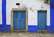 Nine Eleven Prints - Two Wood Faded Blue Doors of the Medieval Village of Obidos Print by David Letts