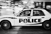 Patrol Car Acrylic Prints - Vancouver police squad patrol car vehicle BC Canada deliberate motion blur Acrylic Print by Joe Fox