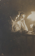 Patricia Hofmeester - Vintage loving couple reading with oil lamp