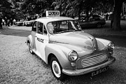 Vintage Police Vehicle Posters - Vintage Morris Minor Police Car At A Car Rally County Down Northern Ireland Uk Poster by Joe Fox