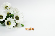 Women Together Posters - Wedding rings and flowers Poster by Michal Bednarek