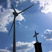 Power Plants Photo Prints - Wind turbine and cross Print by Bernard Jaubert