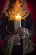 Gold Necklace Posters - Woman In A Blue Medieval Dress Holding A Candle Poster by Lee Avison