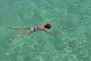 One Piece Swimsuit Prints - Woman snorkeling by turquoise sea Print by Sami Sarkis