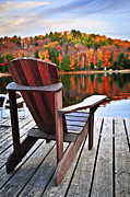 Chair Photo Framed Prints - Wooden dock on autumn lake Framed Print by Elena Elisseeva
