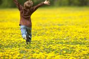 Light-years Prints - Young Boy Running Through Field Of Print by Gemstone Images