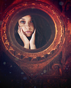 Peep Hole Prints - Young woman looking unsure and afraid looking through peep hole  Print by Sandra Cunningham