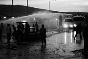 Unrest Framed Prints - Youths Rioting With Burned Out Car Being Hit By Water Canon On Crumlin Road At Ardoyne Framed Print by Joe Fox