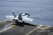 Enterprise Framed Prints - An Fa-18f Super Hornet Launches Framed Print by Stocktrek Images